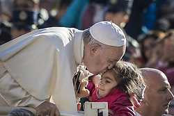 October 19, 2016 - Vatican City, Vatican - Pope Francis kisses a baby as he arrives to celebrate his Weekly General Audience in St. Peter's Square in Vatican City, Vatican. Pope Francis on Wednesday said access to food and water is a basic human right, and called on believers and people of good will everywhaere to take personal responsibility for the needs of their neighbors. (Credit Image: © Giuseppe Ciccia/Pacific Press via ZUMA Wire)