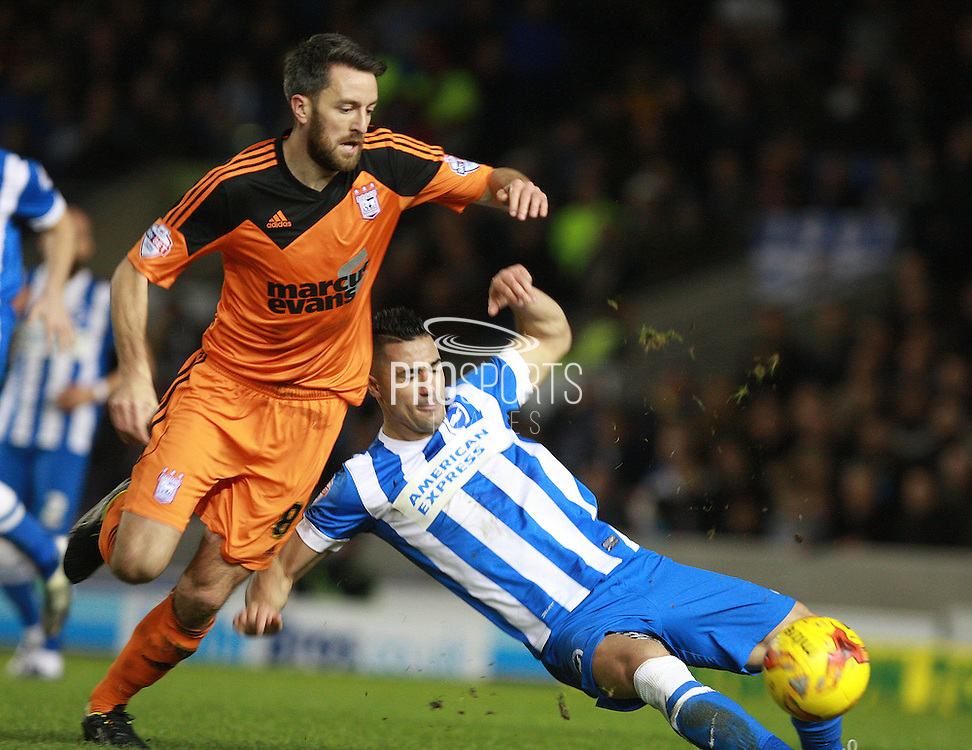 Ipswich Town midfielder Cole Skuse & Brighton central midfielder Beram Kayal battle for possession during the Sky Bet Championship match between Brighton and Hove Albion and Ipswich Town at the American Express Community Stadium, Brighton and Hove, England on 29 December 2015. Photo by Bennett Dean.