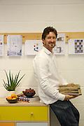 Leonhard Pfeifer, furniture designer, in his Hackney studio, London with the Abbeywood sideboard manufactured in Estonia by Woodman. He holds wood samples from the studio.<br /> CREDIT: Vanessa Berberian for The Wall Street Journal<br /> GURU-Pfeifer