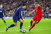 Tottenham Hotspur forward Heung-Min Son (7) goes past Bayern Munich defender Javi Martínez (8) during the Champions League match between Bayern Munich and Tottenham Hotspur at Allianz Arena, Munich, Germany on 11 December 2019.