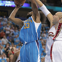 01 November 2008:  New Orleans Hornets center Melvin Ely (33) shoots over Cleveland Cavaliers center Zydrunas Ilgauskas (11) during a 104-92 win by the New Orleans Hornets over the Cleveland Cavaliers at the New Orleans Arena in New Orleans, LA..