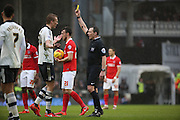 Fulham defender, Dan Burn (33) yellow card during the Sky Bet Championship match between Fulham and Charlton Athletic at Craven Cottage, London, England on 20 February 2016. Photo by Matthew Redman.