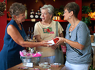 Three women shop for cheese straws at The Front Door in Columbus, Miss. Aug. 16, 2010. The store sells a variety of gourmet foods and kitchen items. (Photo by Carmen K. Sisson/Cloudybright)