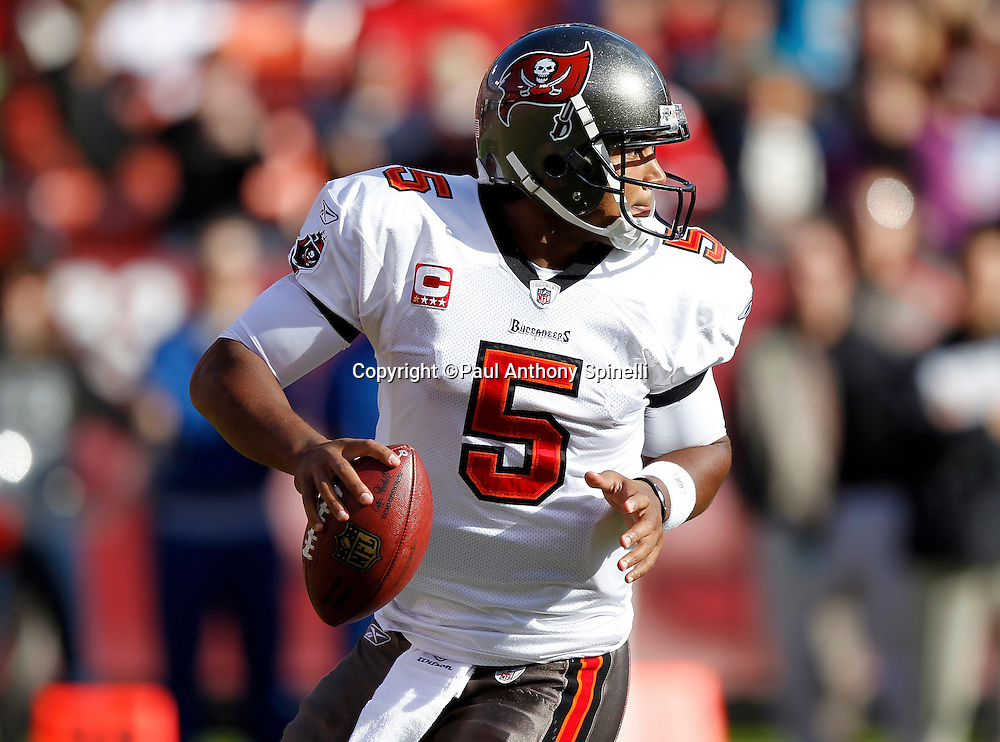 Tampa Bay Buccaneers quarterback Josh Freeman (5) rolls out while looking to pass during the NFL week 11 football game against the San Francisco 49ers on Sunday, November 21, 2010 in San Francisco, California. The Bucs won the game 21-0. (©Paul Anthony Spinelli)
