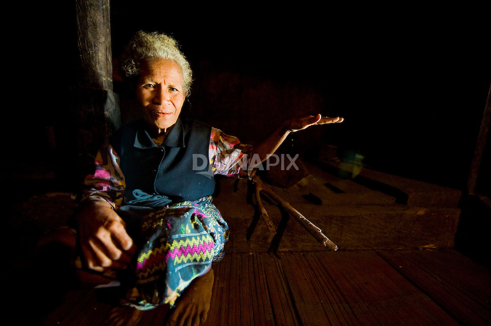 "Old woman from Wogo Village, Bajawa, Flores describes the height of ""ebu gogo"", wild little people of Flores said to have disappeared more than 100 years ago. Some have speculated that if ebu gogo were the descendants of Flores hobbits (Homo floresiensis)."