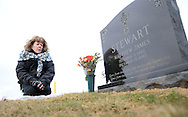 Rosemary Stewart visits the grave of her son, Matthew Stewart Thursday, February 2, 2017 at All Saints Cemetery in Newtown, Pennsylvania. Stewart had purchased a family plot, and the cemetery people placed her son's gravesite too close to the street, leaving the family unable to place the tombstone they had chosen. After much back and forth the cemetery agreed to move the casket over to the next plot further away from the street, thus enabling the tombstone to be placed at the grave. (WILLIAM THOMAS CAIN / For The Philadelphia Inquirer)