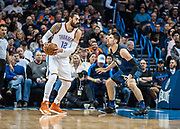 OKLAHOMA CITY, OK - FEBRUARY 26: Oklahoma City Thunder Center Steven Adams (12) looking to make a play while Orlando Magic Center Nikola Vucevic (9) plays defense at Chesapeake Energy Arena Oklahoma City, OK (Photo by Torrey Purvey/Icon Sportswire)