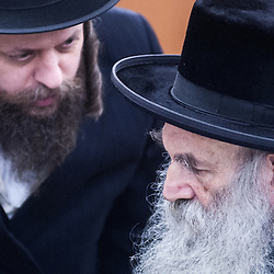 London, UK - 3 December 2014: the community Rabbi (R) as Mr Stephen Williams MP, Parliamentary Under Secretary of State for Communities and Local Government, visits Talmud-Torah Yetev-Lev orthodox Jewish school in Hackney, London