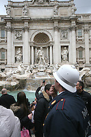 Police man at the Baroque Trevi Fountain in Rome Italy