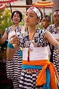 A young lady dancing in the Tenjin Festival (Tenjin Matsuri) in Osaka.