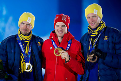14.02.2014, Olympic Park, Adler, RUS, Sochi, 2014, Medaillenfeier Herren Langlauf, 15 km, im Bild Johan Olsson (SWE), Dario Cologna mit Goldmedaille, Daniel Richardsson (SWE) // during Mens Cross Country 15km Medal Ceremony of the Olympic Winter Games Sochi 2014 at the Olympic Park in Adler, Russia on 2014/02/14. EXPA Pictures &copy; 2014, PhotoCredit: EXPA/ Freshfocus/ Urs Lindt<br /> <br /> *****ATTENTION - for AUT, SLO, CRO, SRB, BIH, MAZ only*****