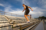 Athletes training by running and sprinting on a track field in Boulder, Colorado.
