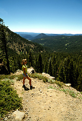 California: Lassen National Park.  Hiker, Model Released..Photo copyright Lee Foster, 510/549-2202, lee@fostertravel.com, www.fostertravel.com..Photo #: calass103