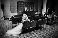 Danielle Willis watches her partner and Allan Border Medal winner Steve Smith speak with Ellyse Perry who won the Belinda Clark Award at the 2018 Allan Border Medal at Crown Palladium on February 12, 2018 in Melbourne, Australia.