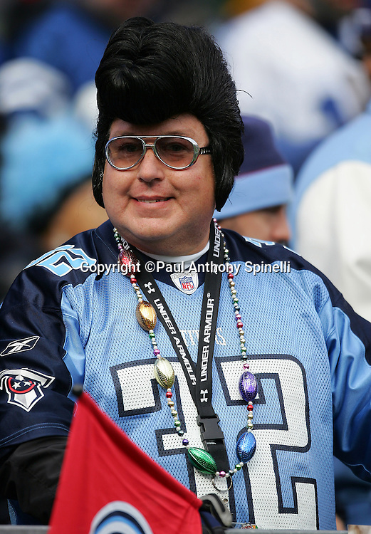 NASHVILLE, TN - DECEMBER 3:  A Tennessee Titans fan wearing an Elvis Presley costume and the jersey of Titans cornerback and punt/kick returner Pacman Jones wears jewelry and smiles at the game against the Indianapolis Colts at LP Field on December 3, 2006 in Nashville, Tennessee. The Titans defeated the Colts 20-17. ©Paul Anthony Spinelli
