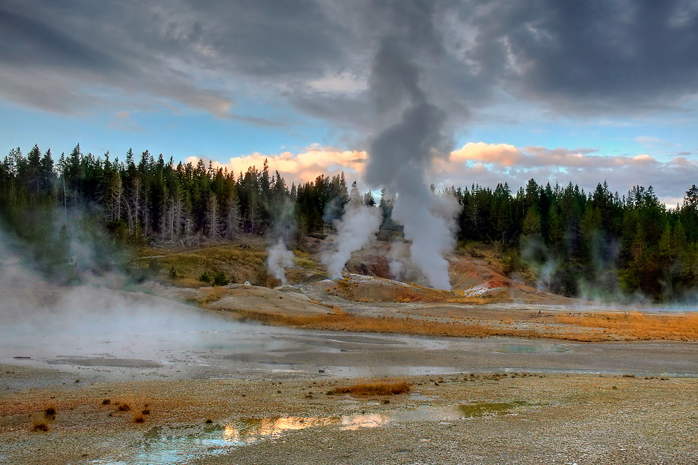 The Porcelain Basin area of Norris Geyser Basin roils with geothermal activity at dawn in Yellowstone National Park, Wyoming.