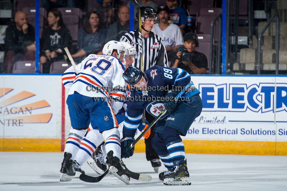 PENTICTON, CANADA - SEPTEMBER 9: Ethan Szypula #68 of Edmonton Oilers faces off against Tyler Boland #89 of Winnipeg Jets on September 9, 2017 at the South Okanagan Event Centre in Penticton, British Columbia, Canada.  (Photo by Marissa Baecker/Shoot the Breeze)  *** Local Caption ***