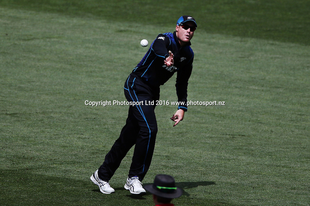 Martin Guptill of New Zealand takes the catch to dismiss Ahmed Shehzad of Pakistan. ANZ International Series, One Day International between New Zealand Back Caps and Pakistan at Eden Park in Auckland, New Zealand. 31 January 2016. Photo: Anthony Au-Yeung / www.photosport.nz