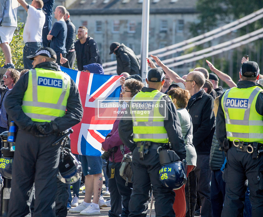 Supporters of republican group Cairde Na Heireann held a march through Glasgow, a week after police in riot gear battled to control another republican march and a counter demonstration. Loyalist demonstrators held a counter demonstration, waving union jacks and making nazi salutes, whilst shoppers, tourists and locals looked on bemused. Police, including officers equipped with riot equipment, were on hand.<br /> <br /> © Dave Johnston / EEm
