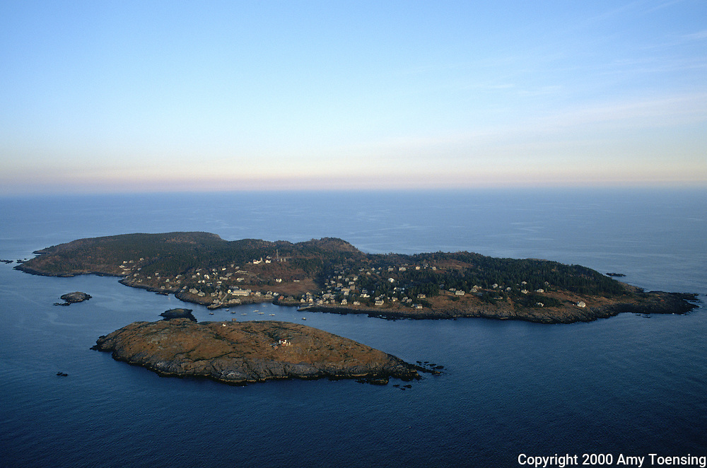 MONHEGAN ISLAND, MAINE - NOVEMBER 03: An aerial view of the island November 3, 2000 on Monhegan Island, Maine. This small, rocky island is ten miles from the nearest mainland, only accessible by boat and barely a square mile in area. Monhegan Island, home to lobstermen and painters and a popular destination for tourists is twelve miles off the coast of Maine. Ringed by high, dark cliffs, its interior a mix of meadows, marsh and spruce groves, Monhegan is one of just 14 true island communities left off the coast of Maine. The island has a 65 permanent, year-round residents and the population grows to around 200 in the summer, with day-trippers adding several hundred more. (Photo by Amy Toensing) _________________________________________<br /> <br /> For stock or print inquires, please email us at studio@moyer-toensing.com.
