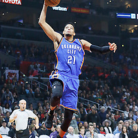 21 December 2015: Oklahoma City Thunder guard Andre Roberson (21) goes for the dunk during the Oklahoma City Thunder 100-99 victory over the Los Angeles Clippers, at the Staples Center, Los Angeles, California, USA.
