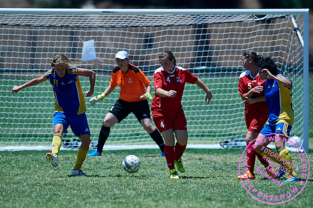 SO Poland athlete (C) fights for the ball with SO Sweden athlete (L) while football women match 7-a-side during fourth day of the Special Olympics World Games Los Angeles 2015 on July 28, 2015 at Balboa Sports Centre in Los Angeles, USA.<br /> USA, Los Angeles, July 28, 2015<br /> <br /> Picture also available in RAW (NEF) or TIFF format on special request.<br /> <br /> For editorial use only. Any commercial or promotional use requires permission.<br /> <br /> Adam Nurkiewicz declares that he has no rights to the image of people at the photographs of his authorship.<br /> <br /> Mandatory credit:<br /> Photo by &copy; Adam Nurkiewicz / Mediasport