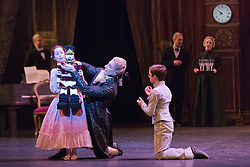 "© Licensed to London News Pictures. 10/12/2014. London, England. L-R. Sereina Mowlem as Clara as a child, Fabian Reimair as Drosselmeyer and Basil James as Freddie as a child. Dress rehearsal for the ballet ""The Nutcracker"" at the London Coliseum. Set to music by Pyotr Ilyich Tchaikovsky, the traditional Christmas ballet is choreographed by Wayne Eagling based on a concept by Toer von Schayk and Wayne Eagling. The English National Ballet Philharmonic orchestra accompanies dancers from the English National Ballet and Students from the English National Ballet School. Children performers are from the Tring Park School for the Performing Arts. The ballet runs at the London Coliseum from 11 December 2014 to 4 January 2015.  With Alina Cojocaru as Clara, Max Westwell as Nutcracker, Alejandro Virellles as Nephew, James Streeter as Mouse King and Fabian Reimair as Drosselmeyer. Photo credit: Bettina Strenske/LNP"