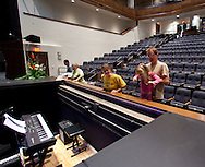 Laura Pitkin (second on right), 6, gets some help from her dad, Rob Svetly (right) to look into the orchestra pit as her mother, Angela Pitkin, all of Coralville, looks on at the open house for the Coralville Center for the Performing Arts in Coralville on Saturday, August 27, 2011.