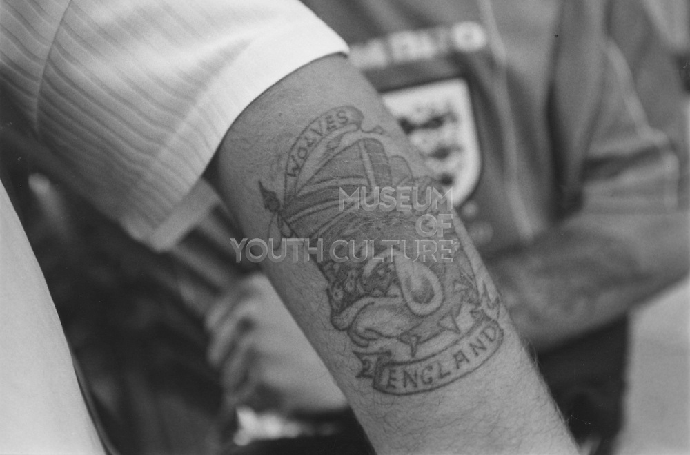 Close up of Wolves England tattoo on a mans arm