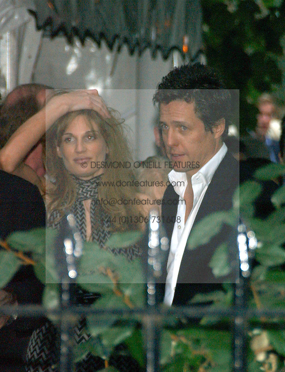 HUGH GRANT and JEMIMA KHAN at Sir David & Lady Carina Frost's annual summer party held in Carlyle Square, Chelsea, London on 5th July 2006.<br /><br />NON EXCLUSIVE - WORLD RIGHTS