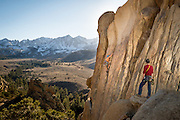 Photographer Dana Felthauser watches as Aaron Livingston puts up an FA on Out of Reach, 5.11. <br /> Eastern Sierra, California