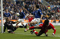Photo. Glyn Thomas.<br /> Leicester City v Liverpool. FA Barclaycard Premiership.<br /> Walkers Stadium, Leicester. 28/03/2004.<br /> Liverpool's Florent Sinama-Pongolle (R) beats Leicester's keeper Ian Walker (L) but just misses the net in the dying minutes of the match.