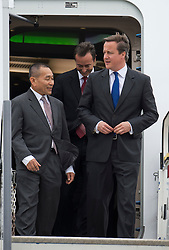 © London News Pictures. 09/07/2012. Farnborough, UK. British Prime Minister David cameron leaving a Malaysian Airlines A380 Airbus with Ahmad Jauhari Yahya CEO of Malaysia Airlines (left) during a walk round of aircraft on day one of the Farnborough International Airshow, in Farnborough, Hampshire, UK on July 9, 2012. FIA is a seven-day international trade fair for the aerospace industry which is held every two years at Farnborough Airport . Photo credit: Ben Cawthra/LNP.