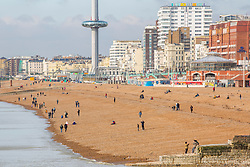 © Licensed to London News Pictures. 20/10/2019. Brighton, UK. Only a handful of people can be seen on the beach in Brighton and Hove as colder weather is hitting the seaside resort. Photo credit: Hugo Michiels/LNP