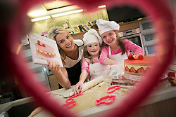Repro Free: 02 October 2013 <br /> Yummie Mummie Pippa O'Connor is pictured at the launch of the MummyPages.ie Mum's Baking Book, with little helpers Alexandra (6) and Talulla McKenna (8) baking the world a better place with all proceeds of the book going to help those with rare illness Friedeich's Ataxia. Priced at just &euro;14.99 this hardback book makes the ideal gift and is available in all good bookstores, Tesco, Home Store + More and Boots pharmacies. With over 250,000 mums online MummyPages.ie is Ireland's largest parenting community. Picture Andres Poveda
