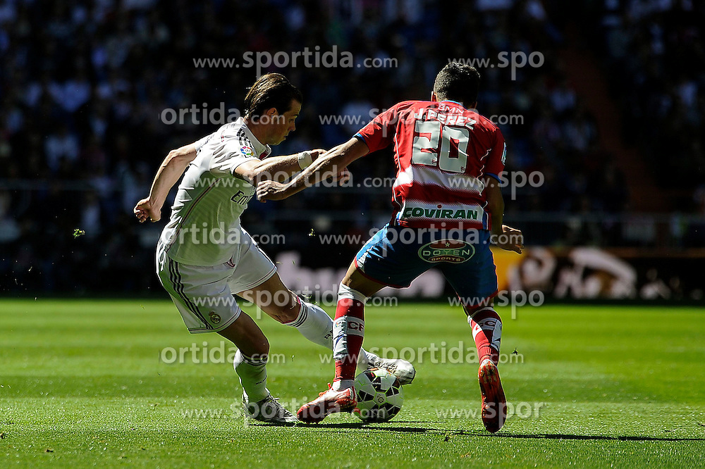 05.04.2015, Estadio Santiago Bernabeu, Madrid, ESP, Primera Division, Real Madrid vs FC Granada, 29. Runde, im Bild Real Madrid&acute;s Gareth Bale and Granada&acute;s Juan Carlos Perez // during the Spanish Primera Division 29th round match between Real Madrid CF and FC Granada at the Estadio Santiago Bernabeu in Madrid, Spain on 2015/04/05. EXPA Pictures &copy; 2015, PhotoCredit: EXPA/ Alterphotos/ Luis Fernandez<br /> <br /> *****ATTENTION - OUT of ESP, SUI*****