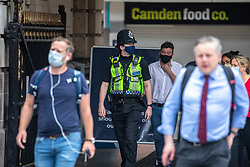 © Licensed to London News Pictures. 14/08/2020. London, UK. Police patrol Victoria Stn in Westminster. A large police presence at Victoria Station this morning as Prime Minister Boris Johnson announces that fines for not wearing a face mask on public transport and shops will rise to £3,200. Photo credit: Alex Lentati/LNP