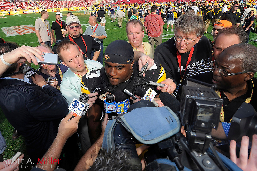 Jan 1, 2009; Tampa, FL, USA; Iowa Hawkeyes running back Shonn Greene (23) is surrounded by the media after the Outback Bowl at the Raymond James Stadium. Iowa won the game 31-10. ©2009 Scott A. Miller