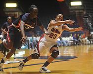 "Ole Miss' Kayla Melson (20) is fouled by Arizona's Ify Ibekwe (3) at the C.M. ""Tad"" Smith Coliseum in Oxford, Miss. on Thursday, November 18, 2010. Arizona won 72-70."
