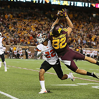 MINNEAPOLIS, MN - SEPTEMBER 01: Drew Wolitarsky #82 of the Minnesota Golden Gophers pulls in a pass while Xavier Crawford #22 of the Oregon State Beavers gets called for pass interference in the second quarter at TCF Bank Stadium on September 1, 2016 in Minneapolis, Minnesota. (Photo by Adam Bettcher/Getty Images) *** Local Caption *** Drew Wolitarsky; Xavier Crawford