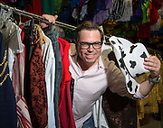 Dave Pierce, the new artistic director of the Grandstand Show, gets ready for Stampede in the costume room at Stampede Park in Calgary on Tuesday June 24, 2014. (Jenn Pierce/Calgary Herald)