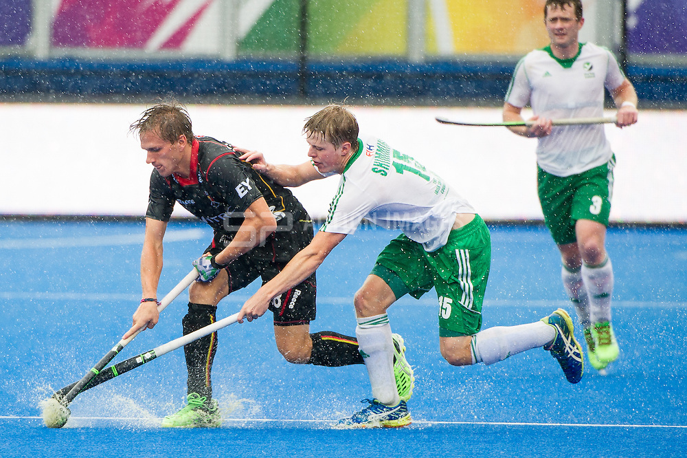 Belgium's Mathew Cobbaert is tackled by Kirk Shimmins of Ireland. Ireland v Belgium - Unibet EuroHockey Championships, Lee Valley Hockey & Tennis Centre, London, UK on 25 August 2015. Photo: Simon Parker