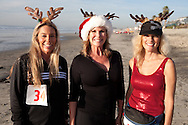 Robin Holmwood, Patti Roberts and Shirley Rogozienski pose before finishing their 5k during the Red Nose Run.