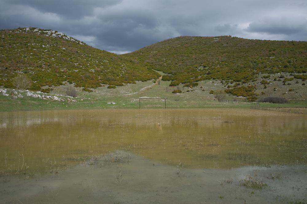 Flooded football pitch near the village of Rakicke, Albania