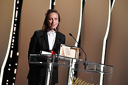 """French director and screenwriter Celine Sciamma is awarded with the Best Screenplay prize for the film """"Portrait of a Lady on Fire"""" on May 25, 2019 during the closing ceremony of the 72nd edition of the Cannes Film Festival in Cannes, southern France. Photo by David Niviere/ABACAPRESS.COM"""