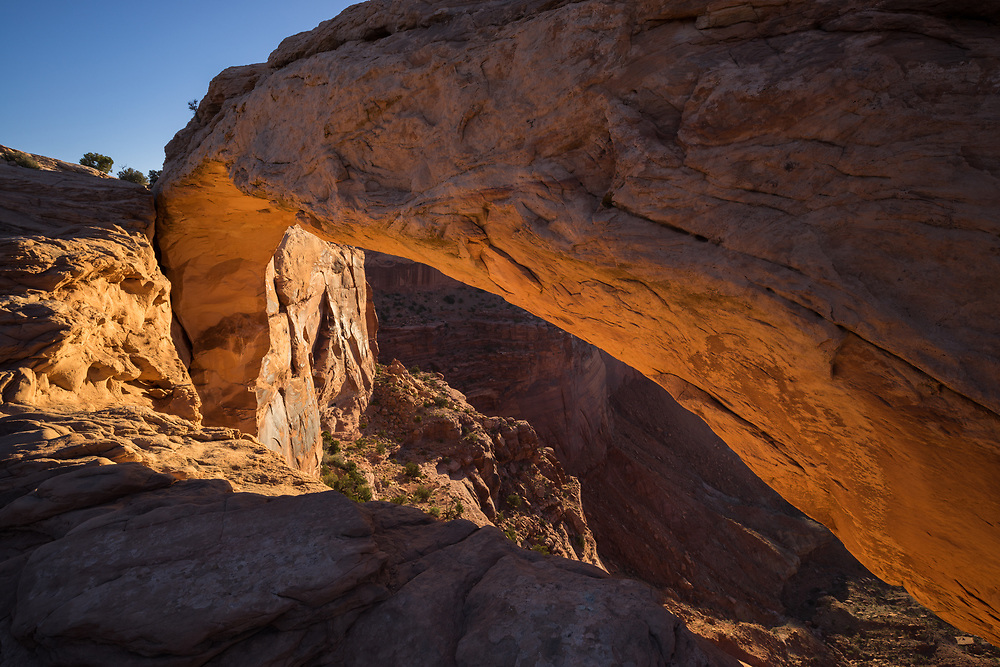Warm light at sunrise on Mesa Arch, Canyonlands National Park, Utah