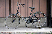 old with dust covered bicycle
