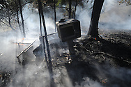 Lafayette County firemen fight a fire on County Road 121 near Abbeville, Miss. on Wednesday, September 29, 2010.