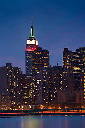 Empire State Building in Red, White, and Green in the New York City Skyline