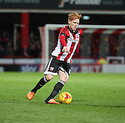Brentford midfielder Ryan Woods dribbling into space during the Sky Bet Championship match between Brentford and Nottingham Forest at Griffin Park, London, England on 21 November 2015. Photo by Matthew Redman.